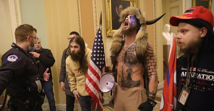 Pro-Trump extremists face off with police Jan. 6 inside the U.S. Capitol.