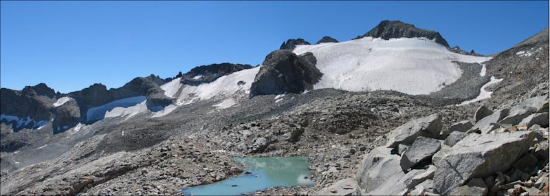 In this Sept. 5, 2004 photo provided by Hassan Basagic is Lyell Glacier in Yosemite National Park. In parts of California's Sierra Nevada, the incursion of trees is sucking marshy meadows dry. Glaciers are melting into mere ice fields. Wildflowers are blooming earlier. And the optimal temperature zone for Giant Sequoias is predicted to rise several thousand feet higher, leaving existing trees at risk of dying over the next 100 years. As the climate warms, scientists studying one of the largest swaths of wilderness in the Continental U.S. are noting changes across national parks, national forests and 3.7 million acres of federally protected wilderness areas that are a living laboratory. (AP Photo/Hassan Basagic)