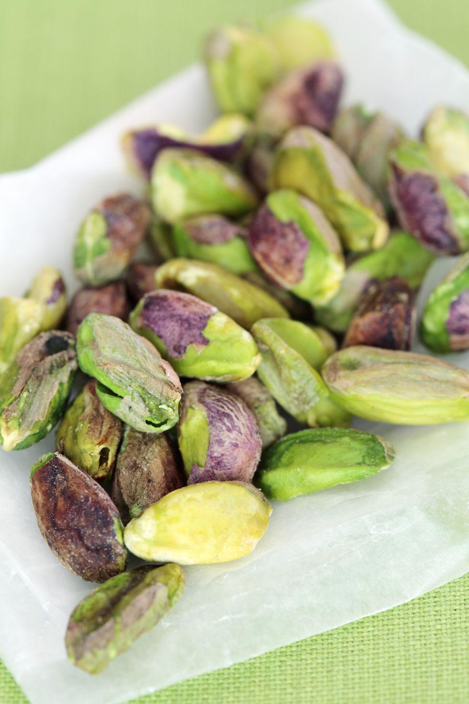 """<p>Pistachios hit the sleep-inducing jackpot, packing in protein, vitamin B6, and magnesium, all of which contribute to better sleep. Refrain from a shell-cracking frenzy, though. """"Don't exceed a 1-ounce portion of nuts,"""" London warns. """"Anything too high in calories can have the reverse effect of <a href=""""https://www.goodhousekeeping.com/health/a38462/why-you-shouldnt-bring-your-phone-into-bed/"""" rel=""""nofollow noopener"""" target=""""_blank"""" data-ylk=""""slk:keeping you awake"""" class=""""link rapid-noclick-resp"""">keeping you awake</a>!""""<br></p>"""