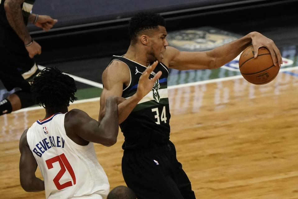 LA Clippers' Patrick Beverley fouls Milwaukee Bucks' Giannis Antetokounmpo during the first half of an NBA basketball game Sunday, Feb. 28, 2021, in Milwaukee. (AP Photo/Morry Gash)