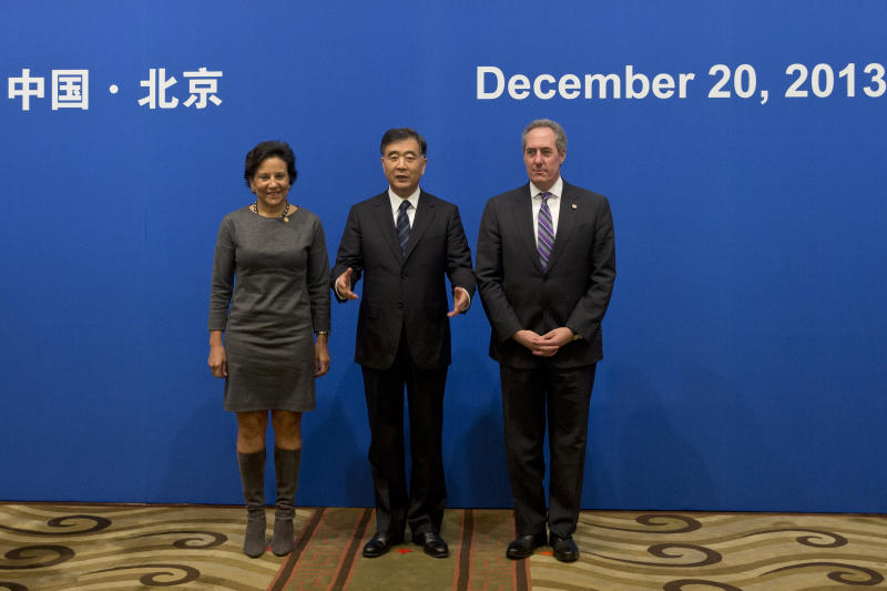 Chinese Vice Premier Wang Yang, center, gestures to end a photo shoot with U.S. Secretary of Commerce Penny Pritzker, left, and U.S. Trade Representative Michael Froman, right, before the opening session of the 24th China-U.S. Joint Commission on Commerce and Trade meeting at Diaoyutai State Guesthouse in Beijing, Friday, Dec. 20, 2013. (AP Photo/Alexander F. Yuan, Pool)