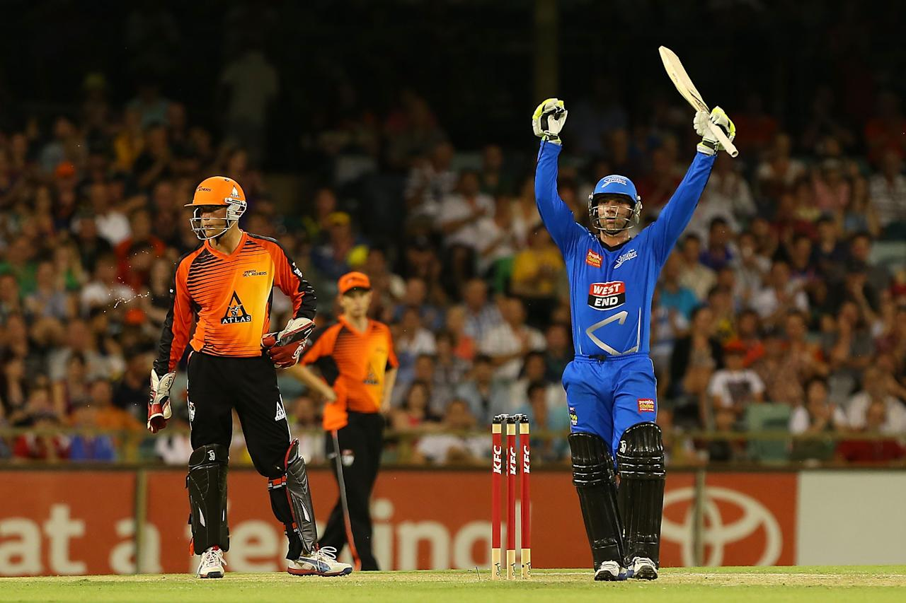 PERTH, AUSTRALIA - DECEMBER 09:  Phillip Hughes of the Strikers celebrates his half century during the Big Bash League match between the Perth Scorchers and Adelaide Strikers at WACA on December 9, 2012 in Perth, Australia.  (Photo by Paul Kane/Getty Images)