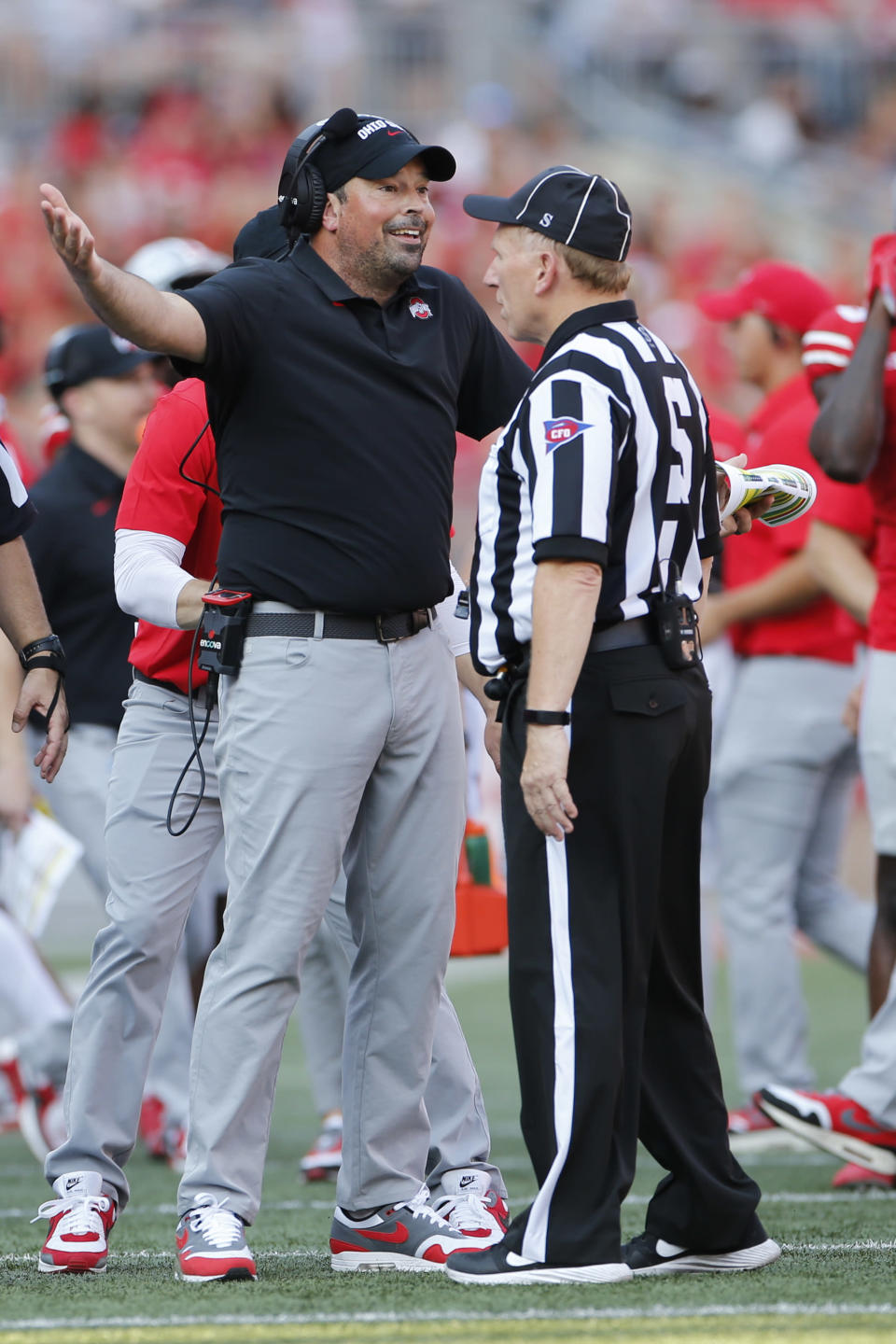 Ohio State head coach Ryan Day, left, questions a call by the referee during the first half of an NCAA college football game against Tulsa, Saturday, Sept. 18, 2021, in Columbus, Ohio. (AP Photo/Jay LaPrete)