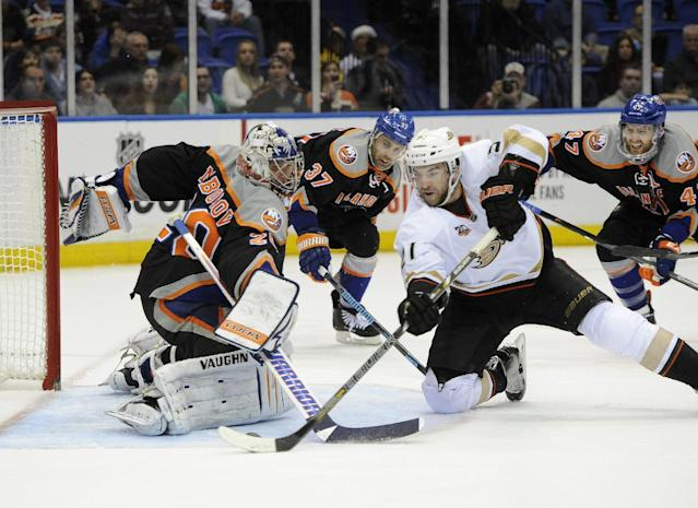 Anaheim Ducks' Kyle Palmieri (21) drives the puck past New York Islanders goalie Evgeni Nabokov (20) to score during the third period of an NHL hockey game Saturday, Dec. 21, 2013, in Uniondale, N.Y. The Ducks defeated the Islanders 5-3. (AP Photo/Kathy Kmonicek)