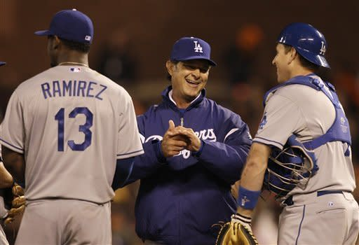 Los Angeles Dodgers manager Don Mattingly, center, laughs with catcher A.J. Ellis, right, as he relieves starting pitcher Stephen Fife with Randy Choate during the seventh inning of a baseball game against the San Francisco Giants in San Francisco, Friday, July 27, 2012. Also pictured at left is third baseman Hanley Ramirez. (AP Photo/Jeff Chiu)