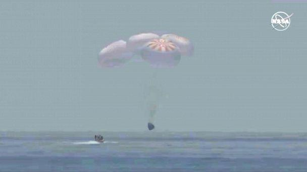 PHOTO: A capsule with NASA astronauts Robert Behnken and Douglas Hurley splashes down in the Gulf of Mexico, August 2, 2020. (NASA via Reuters)