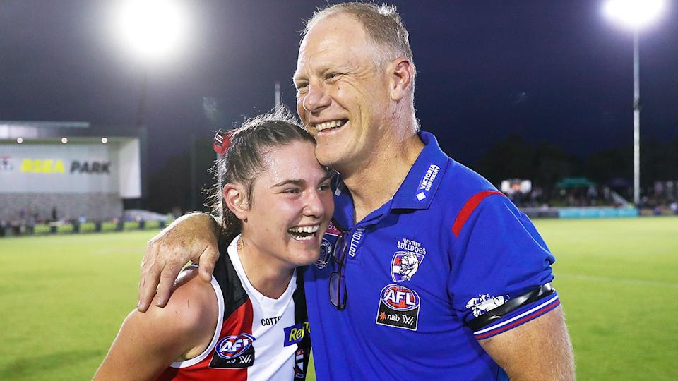Western Bulldogs AFLW coach and St Kilda great Nathan Burke embraces his daughter Alice, following the Saints' six-point win. (Photo by Michael Willson/AFL Photos via Getty Images)