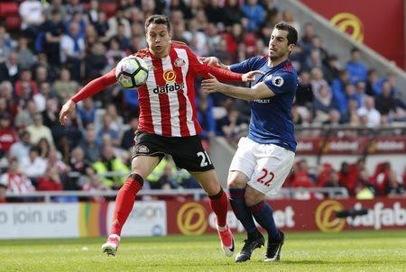 Britain Football Soccer - Sunderland v Manchester United - Premier League - Stadium of Light - 9/4/17 Manchester United's Henrikh Mkhitaryan in action with Sunderland's Javi Manquillo Reuters / Russell Cheyne Livepic