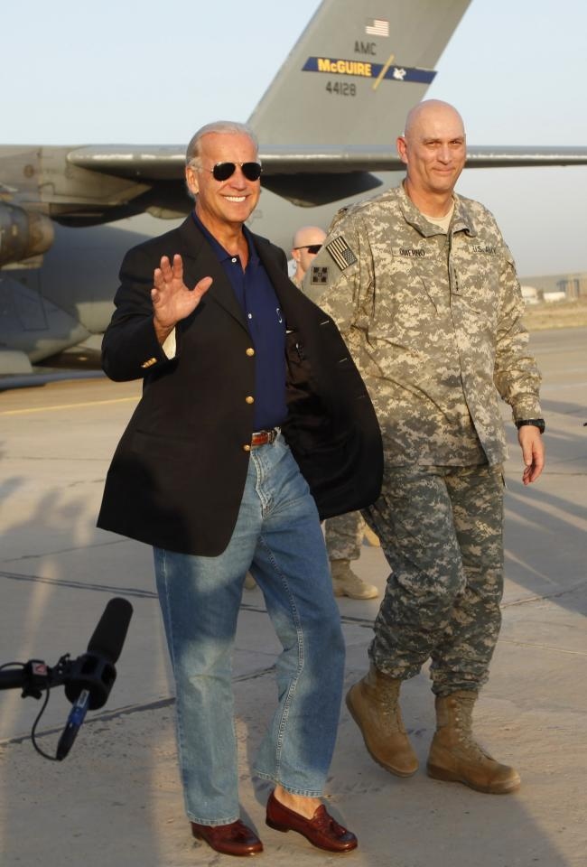 U.S. Vice President Joe Biden, left, walks with Gen. Ray Odierno, right, after he arrived, in Baghdad, Iraq, Monday, Aug. 30, 2010. Vice President Joe Biden returned to Iraq Monday to mark this week's formal end to U.S. combat operations and push the country's leaders to end a six-month postelection stalemate blocking formation of a new government. (AP Photo/Hadi Mizban)