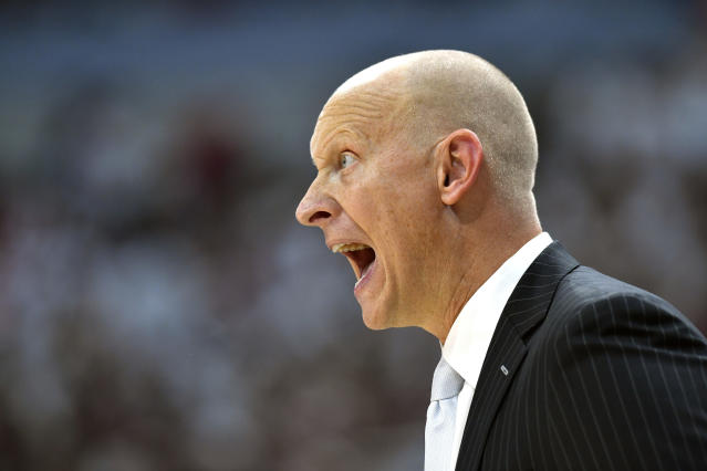 Louisville head coach Chris Mack shouts instructions to his team during the second half of an NCAA college basketball game against Michigan, in Louisville, Ky., Tuesday, Dec. 3, 2019. Louisville won 58-43. (AP Photo/Timothy D. Easley)