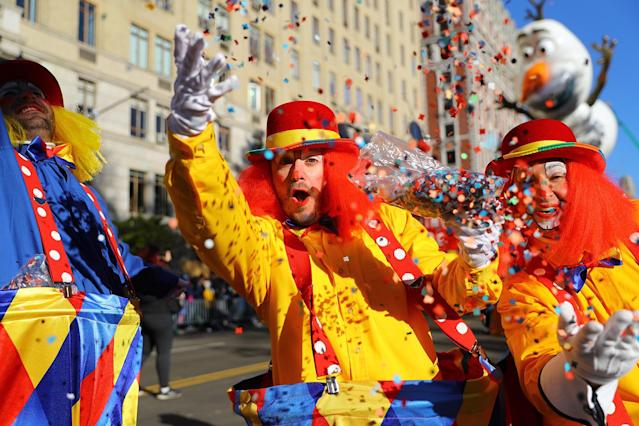 <p>A clown from the Parade Brigade showers the photographer with confetti at the 91st Macy's Thanksgiving Day Parade in New York, Nov. 23, 2017. (Photo: Gordon Donovan/Yahoo News) </p>