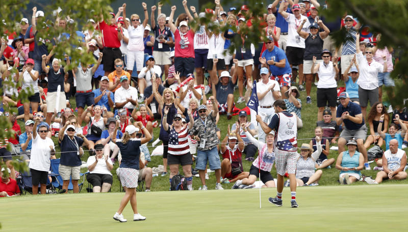 United States' Cristie Kerr celebrates after her singles match against victory in the Solheim Cup golf tournament, Sunday, Aug. 20, 2017, in West Des Moines, Iowa. (AP Photo/Charlie Neibergall)