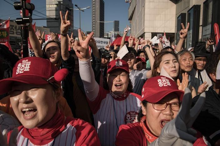 """Women cheer as they attend a rally for South Korean presidential candidate Hong Joon-Pyo, who is known as """"Korea's Trump"""" for his outspoken rhetoric and sexist remarks (AFP Photo/Ed JONES)"""