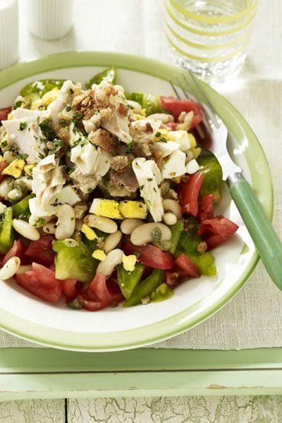 """<p>Mix red beefsteak tomatoes and green heirloom tomatoes in this salad for lots of color.</p><p><a href=""""https://www.goodhousekeeping.com/food-recipes/a10278/layered-tuna-tomatoes-recipe-ghk0810/"""" rel=""""nofollow noopener"""" target=""""_blank"""" data-ylk=""""slk:Get the recipe for Layered Tuna and Tomatoes »"""" class=""""link rapid-noclick-resp""""><em>Get the recipe for Layered Tuna and Tomatoes »</em></a></p>"""