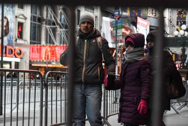 PHOTO: Pedestrians navigate the security barriers in Times Square ahead of the New Year's Eve celebration on Dec. 31, 2017, in New York. (Stephanie Keith/Getty Images, FILE)
