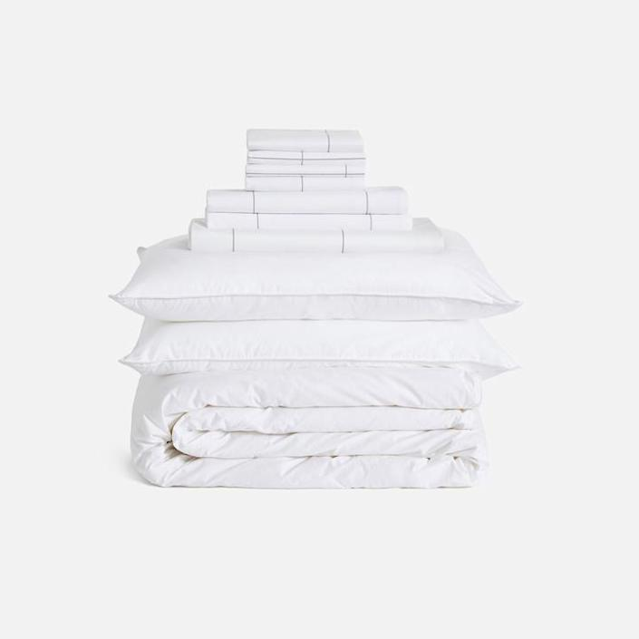 """And for someone you know who might be starting from scratch with their new home, this move-in bundle from Brooklinen comes with everything they need, including a <a href=""""https://www.architecturaldigest.com/gallery/10-eco-friendly-comforters?mbid=synd_yahoo_rss"""" rel=""""nofollow noopener"""" target=""""_blank"""" data-ylk=""""slk:comforter"""" class=""""link rapid-noclick-resp"""">comforter</a>, sheets, <a href=""""https://www.architecturaldigest.com/gallery/best-duvet-covers?mbid=synd_yahoo_rss"""" rel=""""nofollow noopener"""" target=""""_blank"""" data-ylk=""""slk:duvet"""" class=""""link rapid-noclick-resp"""">duvet</a>, and pillow. $465, Brooklinen. <a href=""""https://www.brooklinen.com/products/classic-move-in-bundle?color1=window-pane"""" rel=""""nofollow noopener"""" target=""""_blank"""" data-ylk=""""slk:Get it now!"""" class=""""link rapid-noclick-resp"""">Get it now!</a>"""
