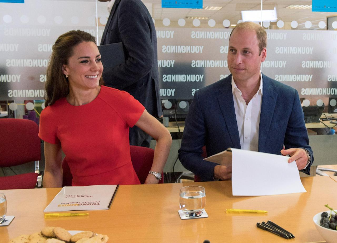 Britain's Catherine, Duchess of Cambridge, and Prince William smile during a visit to a helpline service, as part of a Heads Together campaign in London, Britain, August 25, 2016. REUTERS/Arthur Edwards/Pool