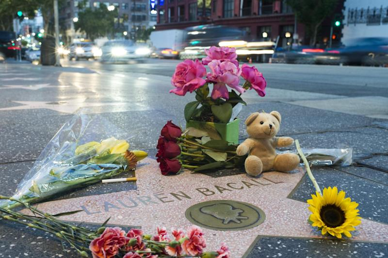 Flowers and momentos are seen on actress Lauren Bacall's star on the Hollywood Walk of Fame, August 12, 2014 (AFP Photo/Robyn Beck)