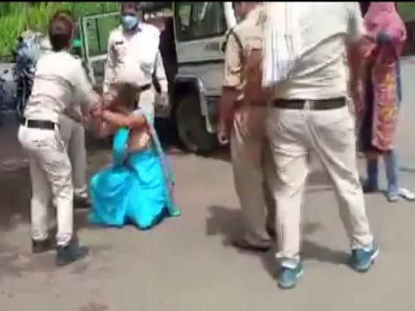 A woman was allegedly beaten up and dragged by some police personnel in MP (Photo/ANI)