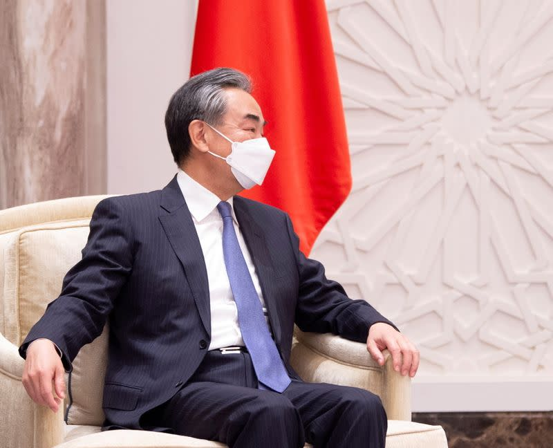 FILE PHOTO: Chinese Foreign Minister Wang Yi takes part in a meeting during a visit to Riyadh, Saudi Arabia