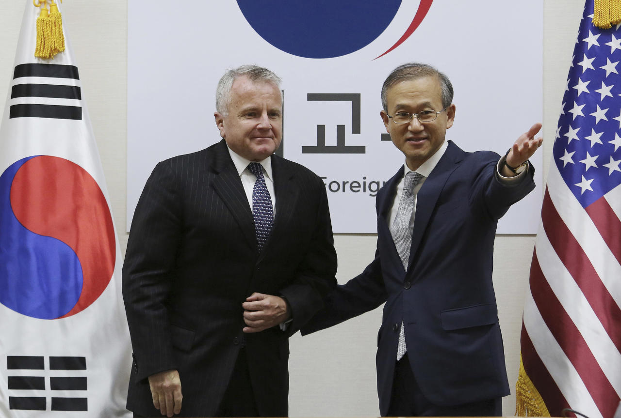 U.S. Deputy Secretary of State John Sullivan, left, is greeted by South Korea Vice Foreign Minister Lim Sung-nam prior to their bilateral meeting at Foreign Ministry in Seoul, South Korea, Wednesday, Oct. 18, 2017. (AP Photo/Ahn Young-joon)