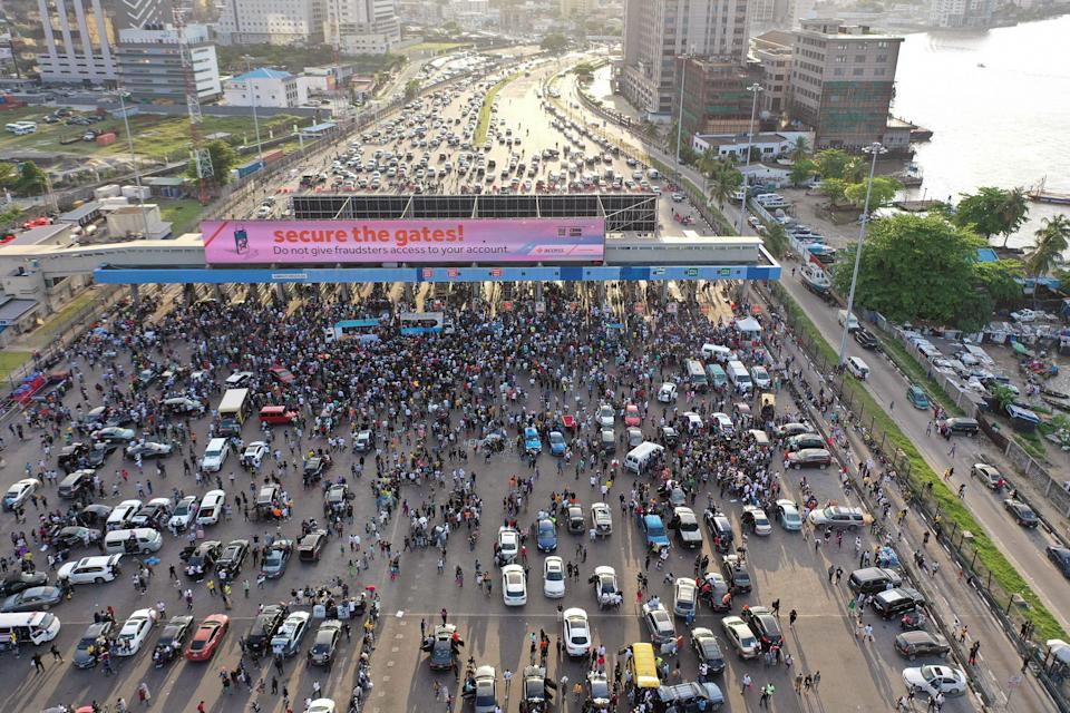 """Protesters gather at Lagos' Lekki toll gate during a demonstration against police brutality on Oct. 15, 2020.<span class=""""copyright"""">Pierre Favennec—AFP/Getty Images</span>"""