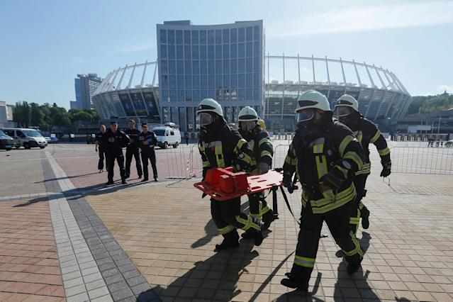 Members of the Ukrainian State Emergency Service take part in a security exercise during preparations for the Champions League final between Real Madrid and Liverpool outside the NSC Olympic stadium in Kiev, Ukraine May 15, 2018. REUTERS/Valentyn Ogirenko