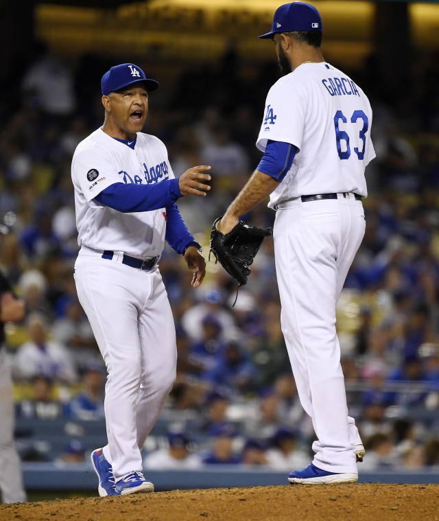 Los Angeles Dodgers relief pitcher Yimi Garcia, right, is taken out of the game by manager Dave Roberts during the eighth inning of a baseball game against the Miami Marlins Saturday, July 20, 2019, in Los Angeles. (AP Photo/Mark J. Terrill)