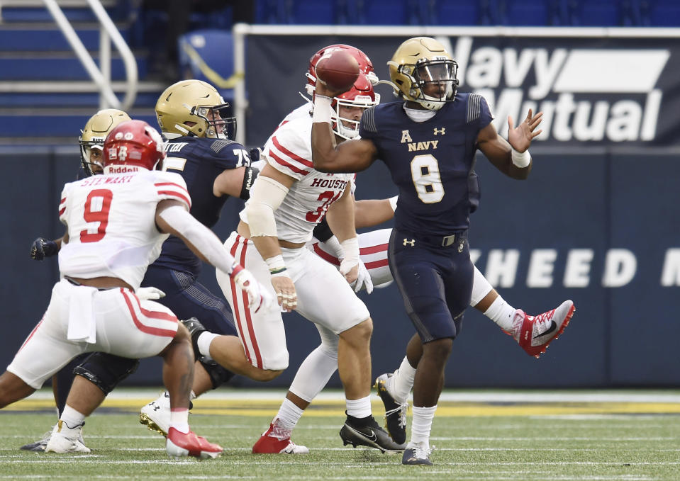 Navy quarterback Dalen Morris (8) attempts a pass against Houston in the second quarter of an NCAA college football game in Annapolis, Md., Saturday, Oct. 24, 2020. (Paul W. Gillespie/The Baltimore Sun via AP)