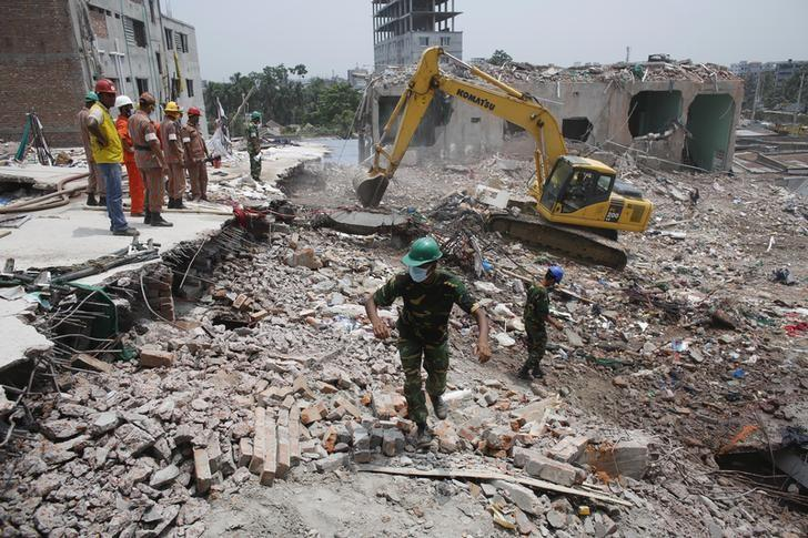 Rescue workers attempt to find survivors from the rubble of the collapsed Rana Plaza building in Savar