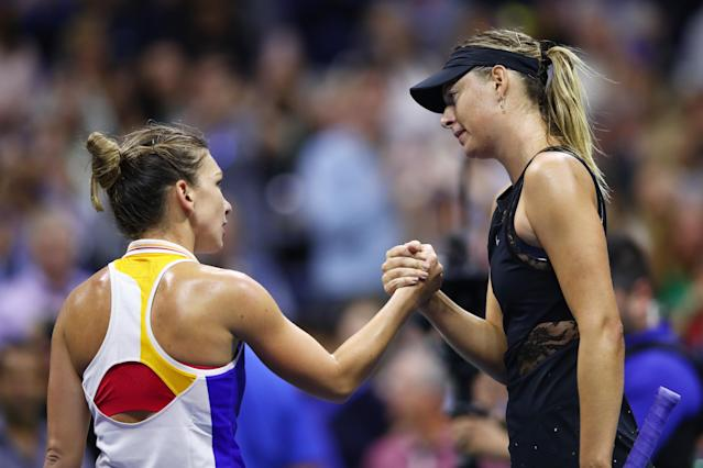<p>Maria Sharapova (R) of Russia shakes hands with Simona Halep of Romania after defeating her in their first round Women's Singles match on Day One of the 2017 US Open at the USTA Billie Jean King National Tennis Center on August 28, 2017 in the Flushing neighborhood of the Queens borough of New York City. (Photo by Clive Brunskill/Getty Images) </p>