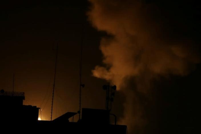 Smoke and flame are seen following an Israeli air strike in Gaza Strip