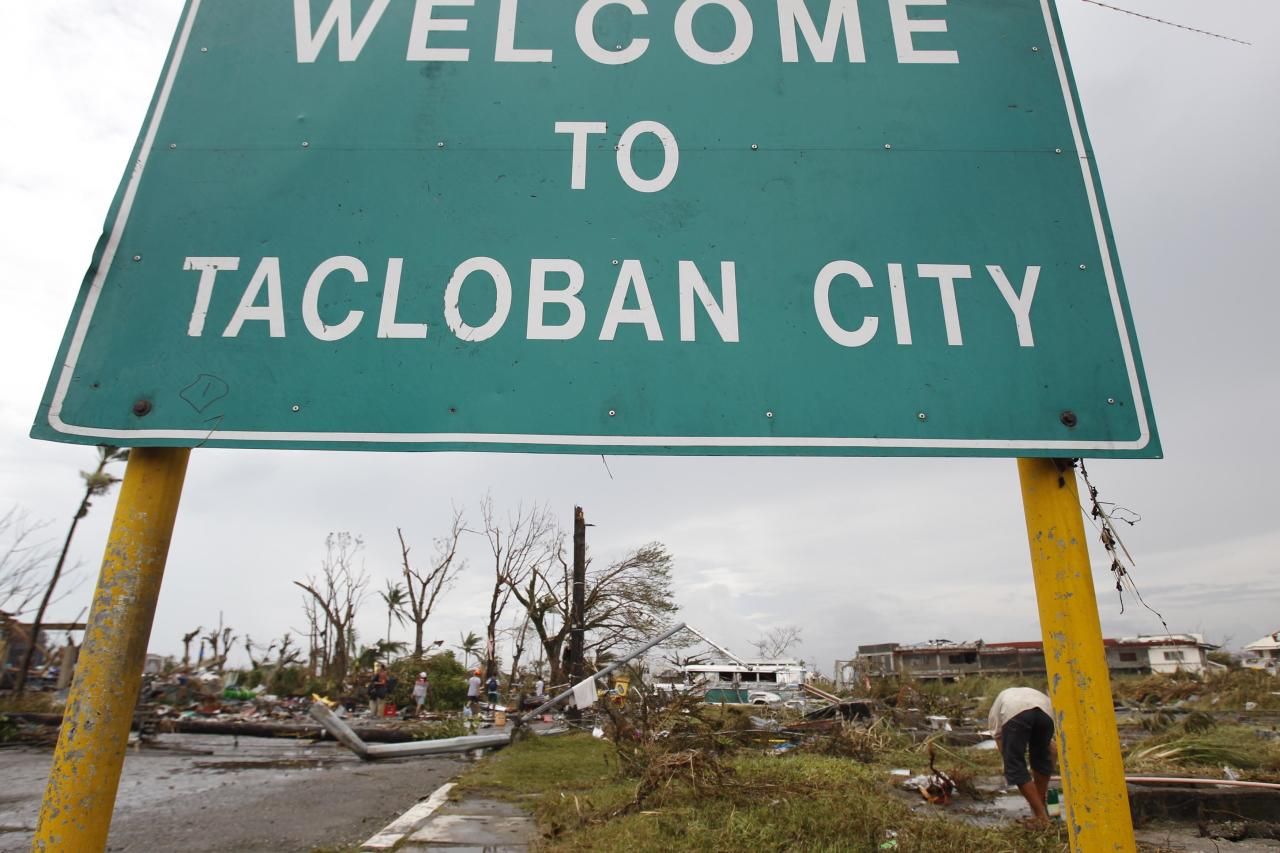 A welcome sign is seen at the entrance of battered Tacloban city, after super Typhoon Haiyan, central Philippines