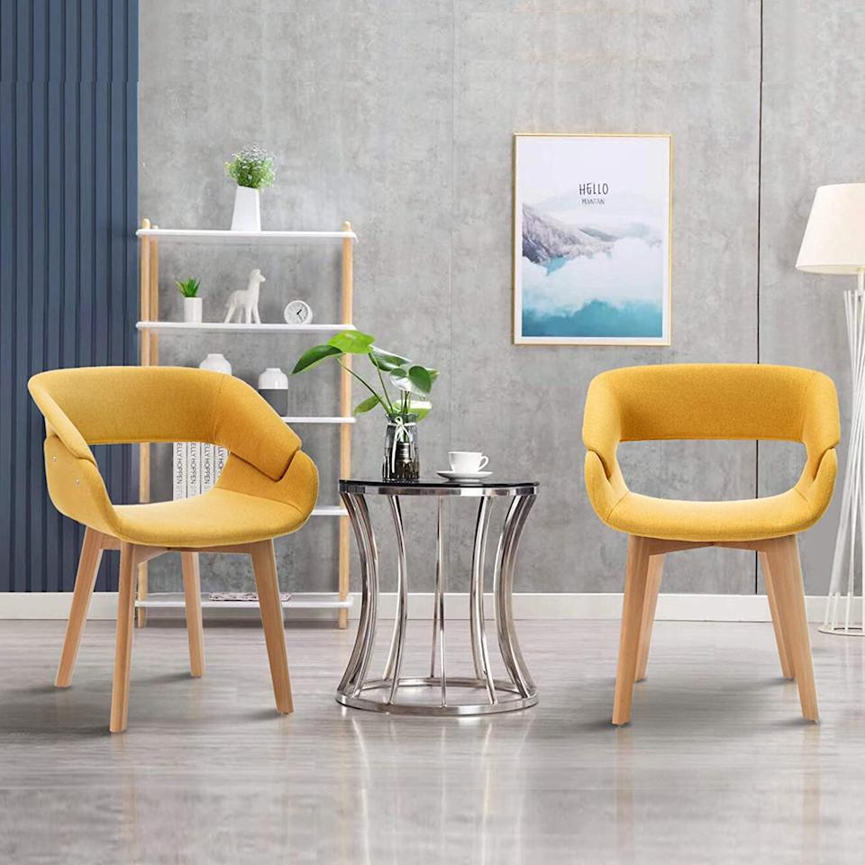 """<h2><a href=""""https://www.amazon.com/dp/B07ZWN3PSD"""" rel=""""nofollow noopener"""" target=""""_blank"""" data-ylk=""""slk:Ivinta Set-of-2 Mid-Century Accent Arm Chairs"""" class=""""link rapid-noclick-resp"""">Ivinta Set-of-2 Mid-Century Accent Arm Chairs</a></h2> <br>Don't sacrifice style for space with an artful but compact seating solution that can stand in as an elegantly streamlined accent chair.<br><br><strong>ivinta Store</strong> Ivinta Set-of-2 Mid-Century Accent Arm Chairs, $, available at <a href=""""https://www.amazon.com/dp/B07ZWN3PSD"""" rel=""""nofollow noopener"""" target=""""_blank"""" data-ylk=""""slk:Amazon"""" class=""""link rapid-noclick-resp"""">Amazon</a>"""