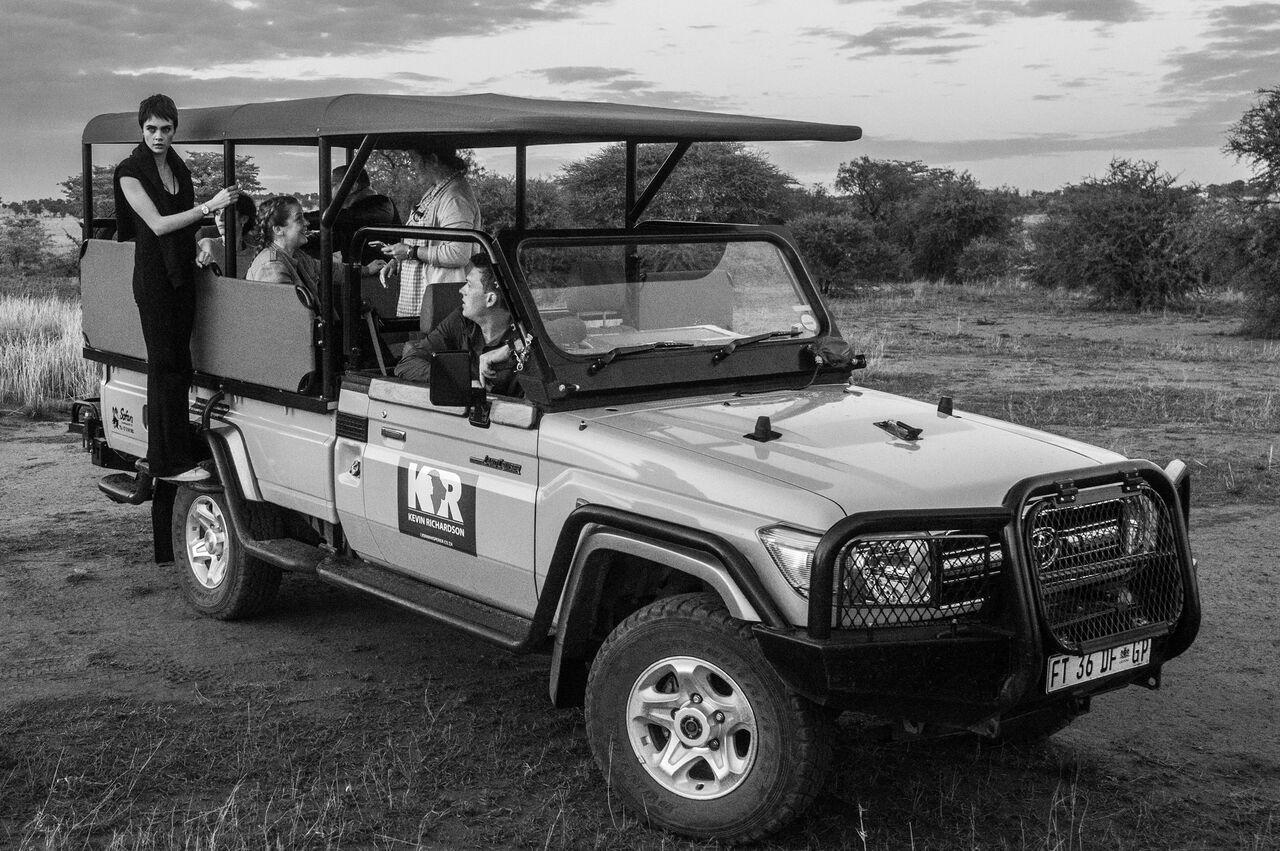 <p>In the presence of lions, Cara demonstrates her strength and humility. Source: David Yarrow/TAG </p>