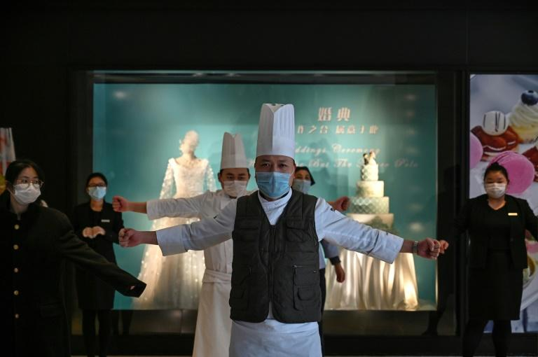 Employees at a hotel in Wuhan, China on January 28, 2020