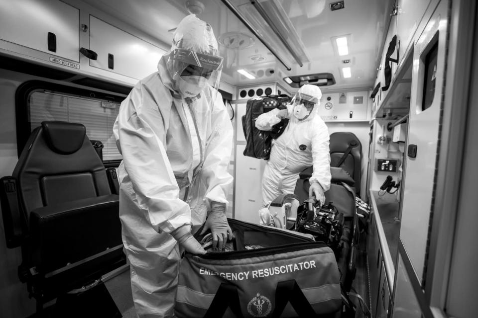 Ambulance crews are required to wear full PPE when performing certain procedures on suspected Covid patients (Liam McBurney/PA)