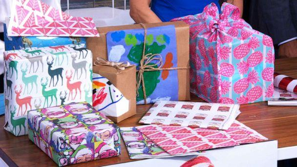PHOTO: ABC News' Becky Worley shares gift-wrapping alternatives with Sara Haines and Michael Strahan on 'Good Morning America' on Dec. 10, 2019. Options featured include recyclable wrapping paper, using children's drawings or using old clothing. (ABC News)