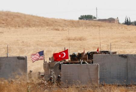 FILE PHOTO: Turkish and U.S. troops return from a joint U.S.-Turkey patrol in northern Syria, as it is pictured from near the Turkish town of Akcakale