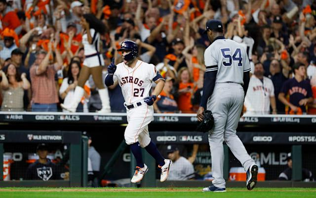 Houston Astros' Jose Altuve celebrates after defeating the New York Yankees in Game 6 - AP