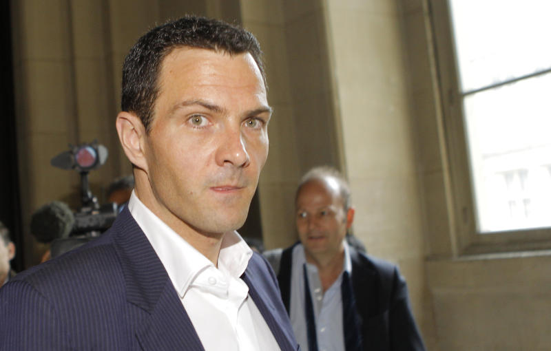 FILE - In this June, 4  2012 file photo, French trader Jerome Kerviel arrives at the Paris courthouse. The Paris appeals court on Wednesday, Oct. 24, 2012, ordered Kerviel, a former Societe Generale trader, to spend three years in prison and pay back a staggering €4.9 billion (about $7 billion) in damages for one of the biggest trading frauds in history. (AP Photo/Jacques Brinon, File)