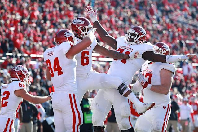 "PISCATAWAY, NJ – NOVEMBER 05: <a class=""link rapid-noclick-resp"" href=""/ncaaf/players/256657/"" data-ylk=""slk:Camion Patrick"">Camion Patrick</a> #6 of Indiana celebrates with teammates after scoring a touchdown against Rutgers on November 5, 2016. (Photo by Michael Reaves/Getty Images)"