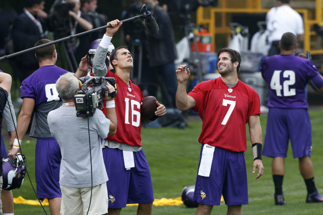 Minnesota Vikings' quarterback Christian Ponder, center right, and quarterback Matt Cassel, center left, fool around with a microphone during their football practice at the Grove Hotel in Watford, England, Wednesday, Sept. 25, 2013. Vikings play Pittsburgh Steelers on Sunday in a NFL football game at Wembley Stadium in London. (AP Photo/Sang Tan)