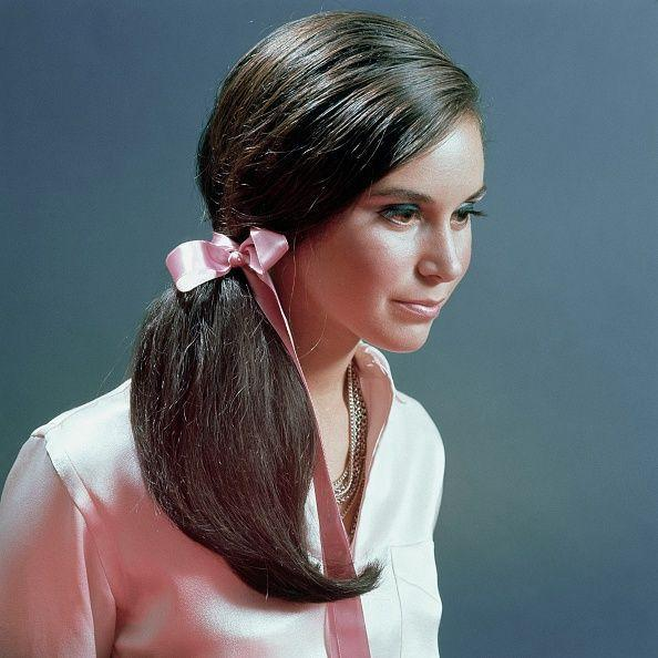 <p>A '60s ponytail wasn't complete without lots of volume and, of course, a ribbon to top it off. But by the end of the decade, it was the side pony that really stood out amongst the rest. </p>