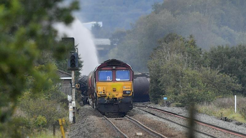 Fire on derailed diesel freight train 'could burn for days'