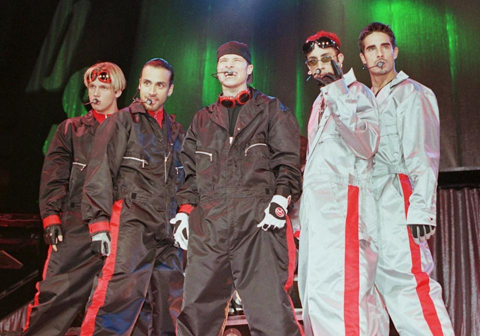 FILE - In this July 8, 1998 file photo, the boy band group the Backstreet Boys, from left, Nick Carter, Howie Dorough, Brian Littrell, A.J. McLean, and Kevin Richardson, perform before a sold out crowd in Charlotte, N.C. The Backstreet Boys were one of the most popular boy bands in the world, selling millions of albums and dominating the music scene in the 90s and 2000s with other groups like *NSYNC. (AP Photo/Rick Havner, file)
