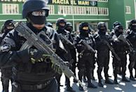 Members of Bolivia's GAT anti-terrorist unit stand guard as they are presented in La Paz, on December 3