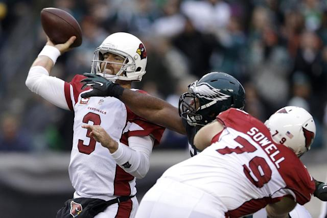 Arizona Cardinals' Carson Palmer passes under pressure from Philadelphia Eagles' Brandon Graham during the second half of an NFL football game, Sunday, Dec. 1, 2013, in Philadelphia. (AP Photo/Matt Rourke)