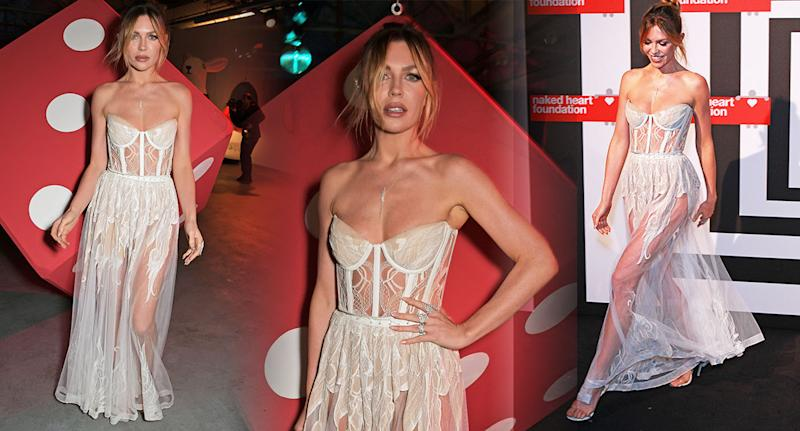 Abbey Clancy: The lingerie model wears a semi-sheer gown for a charity event. [Photo: Getty]