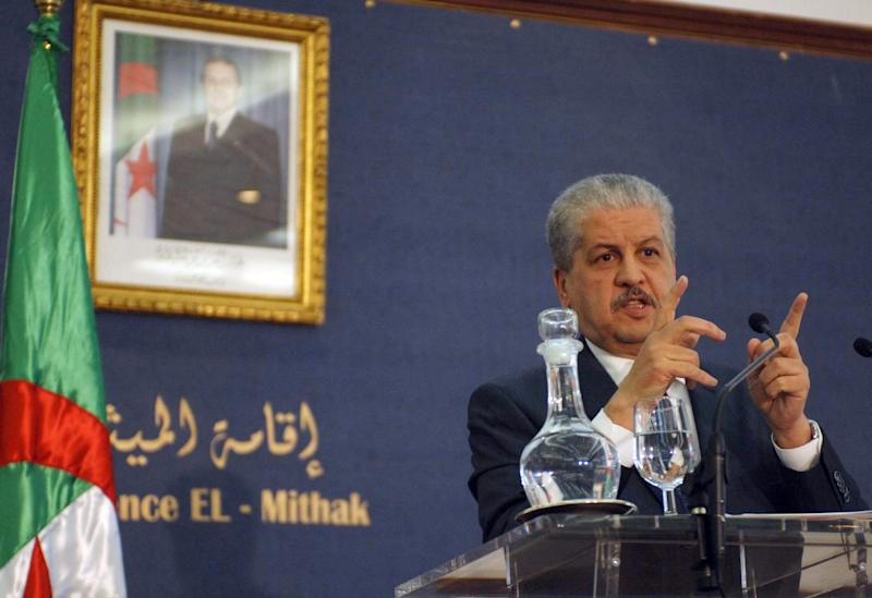 FILE - This Monday Jan. 21, 2013, file photo shows Algerian Prime Minister Abdelmalek Sellal answering questions during a press conference held in Algiers, Algeria. At left is a portrait of Algerian President, Abdelaziz Bouteklika. The Algerian government announced Friday, Jan. 17, 2014, the official date of its presidential elections, yet with just 90 days to go before one of the most important votes in its history, it is not yet clear who is even running. The presidential elections, now scheduled for April 17, could possibly see the handing over of power to a new generation and for the first time Algeria would be led by someone who didn't fight in the 1958-1962 war for independence against France. (AP Photo/Sidali Djarboub, File)